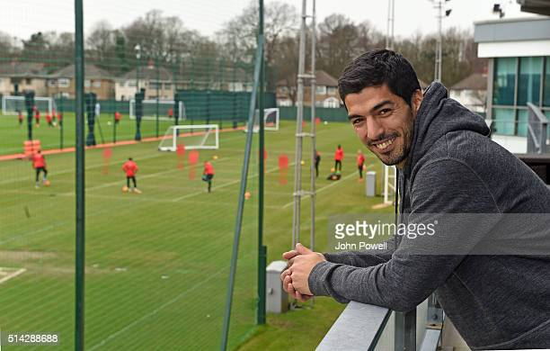 Luis Suarez of Barcelona watches his old club Liverpool train from the balcony at Melwood training ground on March 8 2016 in Liverpool England