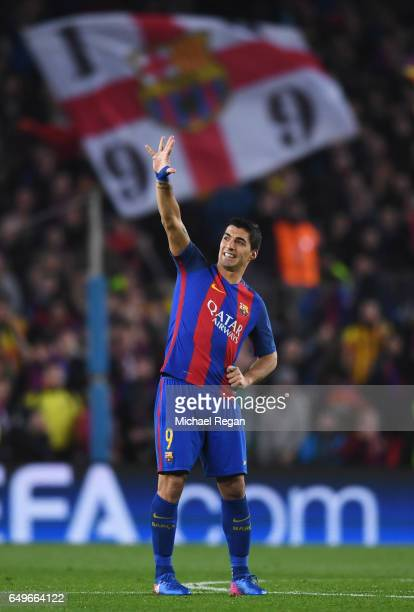 Luis Suarez of Barcelona waves prior to the start of the second half during the UEFA Champions League Round of 16 second leg match between FC...