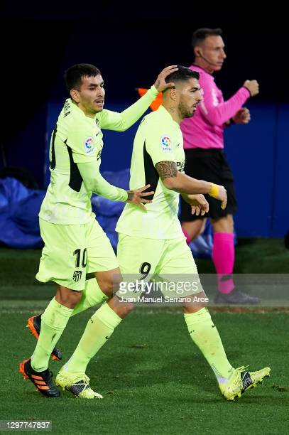 Luis Suarez of Club Atletico de Madrid celebrates with his teammate Angel Correa of Club Atletico de Madrid after scoring the opening goal during the...