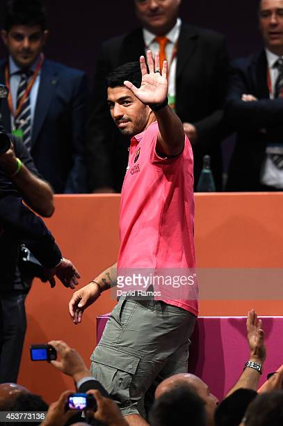 Luis Suarez of FC Barcelona acknowledges the FC Barcelona supporters during the new FC Barcelona players presentation as part of the FC Barcelona...