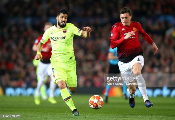 Luis Suarez of FC Barcelona and Victor Lindelof of Manchester United battle for the ball during the UEFA Champions League Quarter Final first leg...