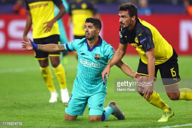 Luis Suarez of FC Barcelona apeeals as Mats Hummels of Borussia Dortmund looks on during the UEFA Champions League group F match between Borussia...