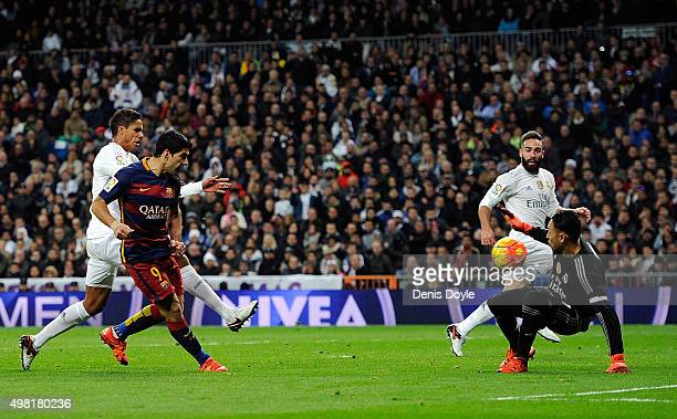 Luis Suarez of FC Barcelona beats Keylor Navas of Real Madrid to score his team's 4th goal during the La Liga match between Real Madrid and Barcelona...