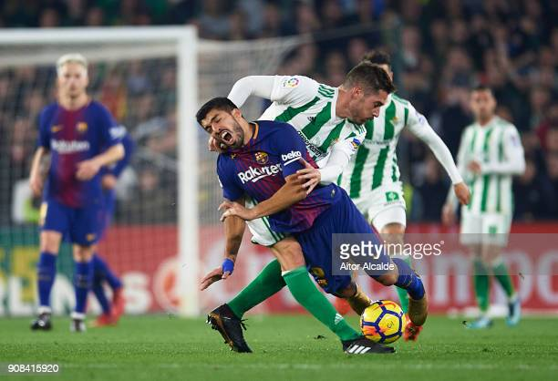 Luis Suarez of FC Barcelona being fouled by Javi Garcia of Real Betis Balompie during the La Liga match between Real Betis and Barcelona at Estadio...