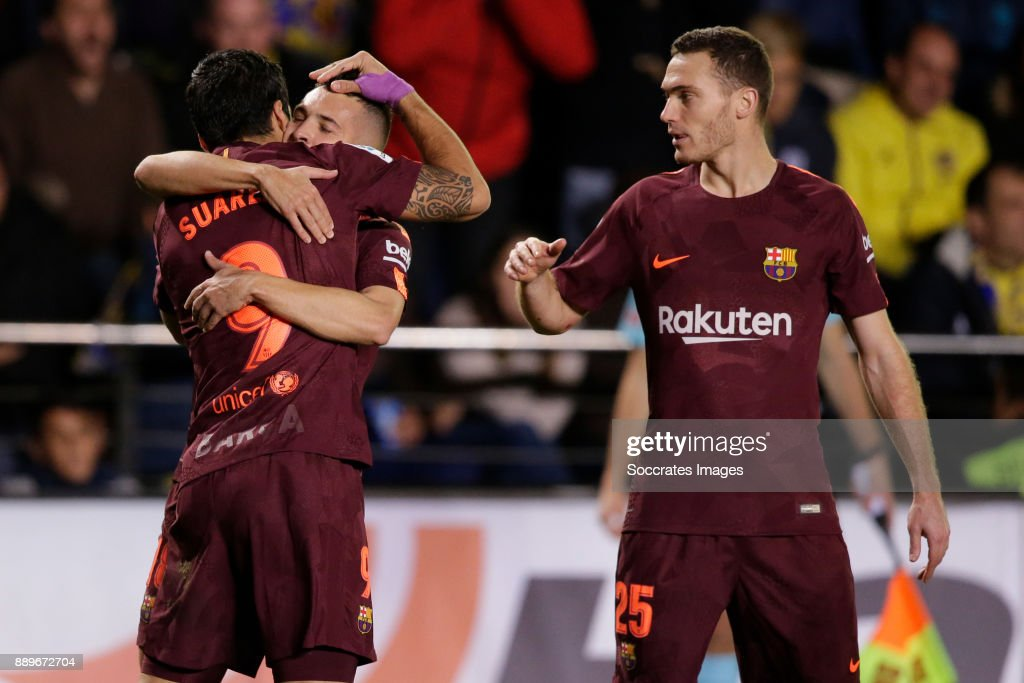 Luis Suarez of FC Barcelona celebrates 0-1 with Jordi Alba of FC Barcelona, Thomas Vermaelen of FC Barcelona during the Spanish Primera Division match between Villarreal v FC Barcelona at the Estadio de la Ceramica on December 10, 2017 in Castellon Spain