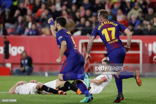 Luis Suarez of FC Barcelona celebrates 21 Paco Alcacer of FC Barcelona during the La Liga Santander match between Sevilla v FC Barcelona at the...