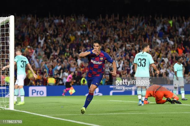 Luis Suarez of FC Barcelona celebrates after he scores his sides second goal during the UEFA Champions League group F match between FC Barcelona and...