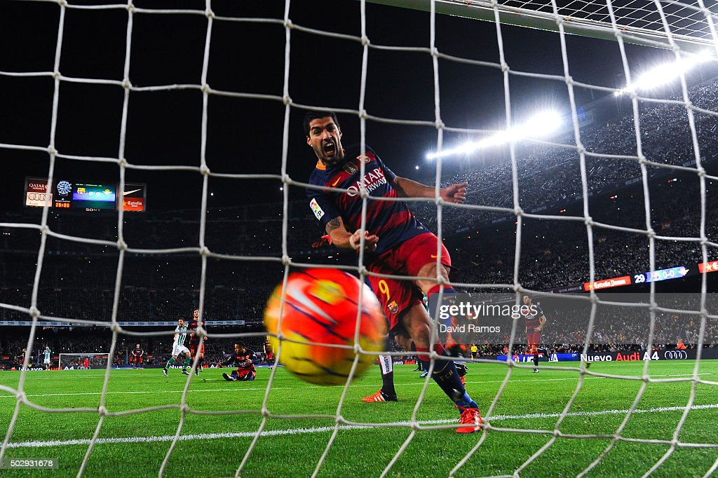 Luis Suarez of FC Barcelona celebrates after Heiko Westermann of Real Betis Balompie scored an own goal during the La Liga match between FC Barcelona and Real Betis Balompie at Camp Nou on December 30, 2015 in Barcelona, Spain.