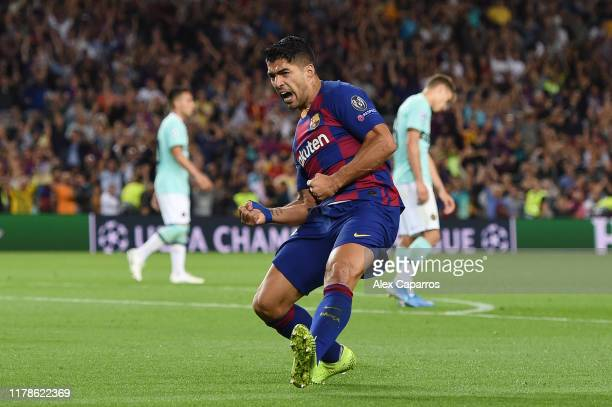 Luis Suarez of FC Barcelona celebrates after scoring his sides first goal during the UEFA Champions League group F match between FC Barcelona and FC...