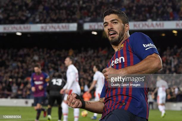 Luis Suarez of FC Barcelona celebrates after scoring his sides third goal during the La Liga match between FC Barcelona and SD Eibar at Camp Nou on...