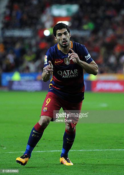 Luis Suarez of FC Barcelona celebrates after scoring his team's 3rd goal during the La Liga match between Sporting Gijon and FC Barcelona at Estadio...
