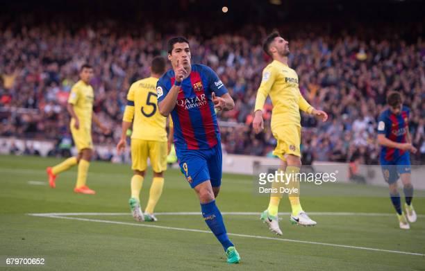 Luis Suarez of FC Barcelona celebrates after scoring his team's 3rd goal during the La Liga match between FC Barcelona and Villarreal CF at Camp Nou...