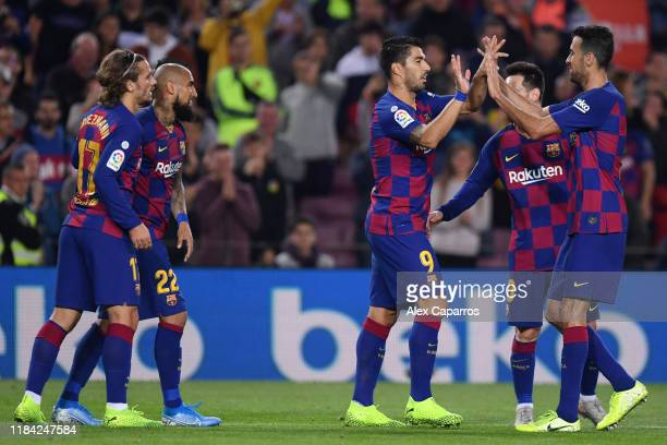 Luis Suarez of FC Barcelona celebrates after scoring his team's fifth goal with his team mates during the Liga match between FC Barcelona and Real...