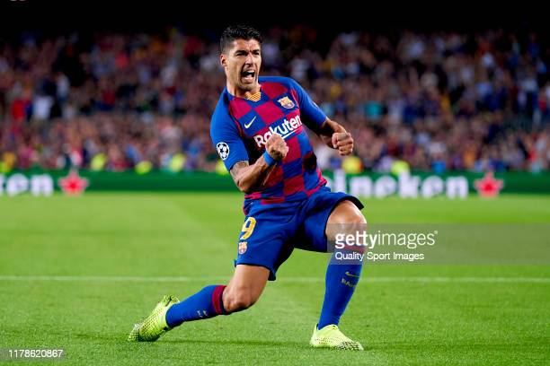 Luis Suarez of FC Barcelona celebrates after scoring his team's first goal during the UEFA Champions League group F match between FC Barcelona and...