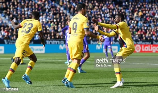 Luis Suarez of FC Barcelona celebrates after scoring his team's first goal with teammates Samuel Umtiti and Ousmane Dembele of FC Barcelona during...