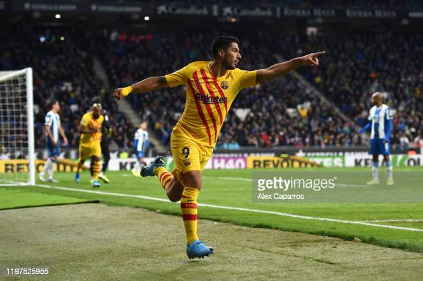 Luis Suarez of FC Barcelona celebrates after scoring his team's first goal during the La Liga match between RCD Espanyol and FC Barcelona at RCDE...