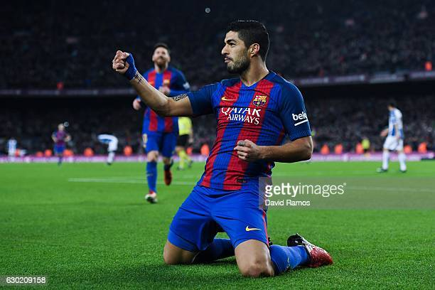 Luis Suarez of FC Barcelona celebrates after scoring his team's first goal during the La Liga match between FC Barcelona and RCD Espanyol at the Camp...