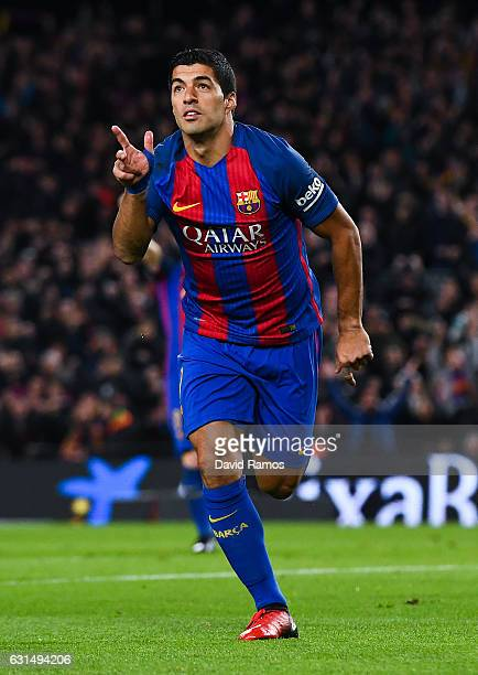 Luis Suarez of FC Barcelona celebrates after scoring his team's first goal during the Copa del Rey round of 16 second leg match between FC Barcelona...