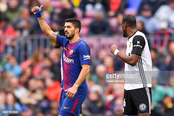 Luis Suarez of FC Barcelona celebrates after scoring his team's first goal during the La Liga match between Barcelona and Valencia at Camp Nou on...