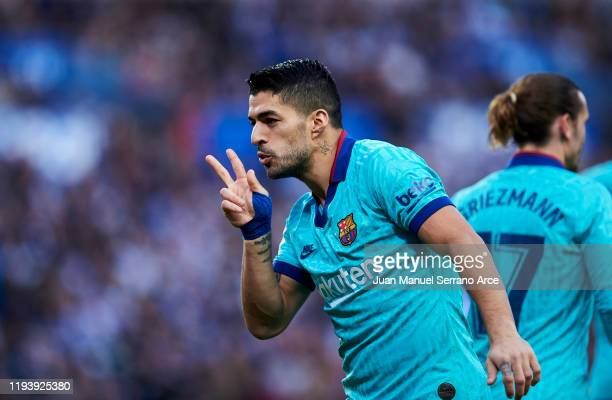 Luis Suarez of FC Barcelona celebrates after scoring his team's second goal during the Liga match between Real Sociedad and FC Barcelona at Estadio...