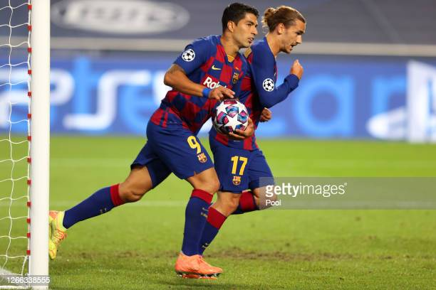 Luis Suarez of FC Barcelona celebrates after scoring his team's second goal during the UEFA Champions League Quarter Final match between Barcelona...