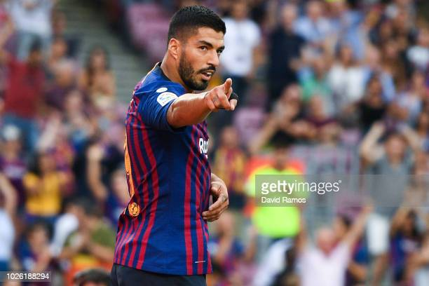 Luis Suarez of FC Barcelona celebrates after scoring his team's third goal during the La Liga match between FC Barcelona and SD Huesca at Camp Nou on...