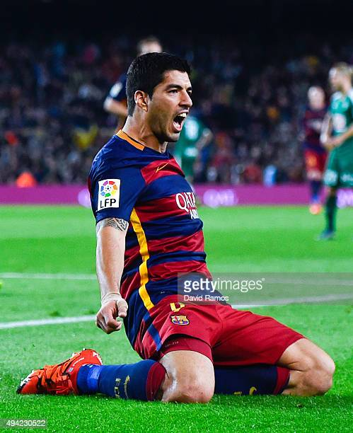 Luis Suarez of FC Barcelona celebrates after scoring his team's third goal during the La Liga match between FC Barcelona and SD Eibar at Camp Nou on...