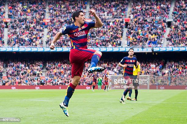 Luis Suarez of FC Barcelona celebrates after scoring his team's third goal during the La Liga match between FC Barcelona and RCD Espanyol at Camp Nou...