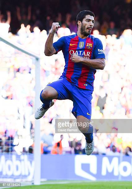 Luis Suarez of FC Barcelona celebrates after scoring his team's third goal during the La Liga match between FC Barcelona and RC Deportivo La Coruna...