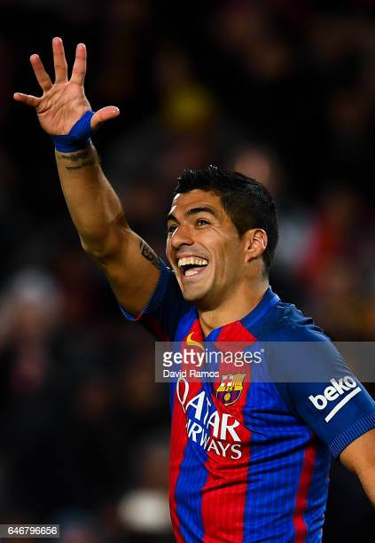 Luis Suarez of FC Barcelona celebrates after scoring his team's third goal during the La Liga match between FC Barcelona and Real Sporting de Gijon...