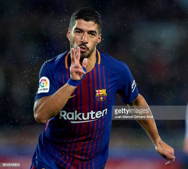 Luis Suarez of FC Barcelona celebrates after scoring his team's third goal during the La Liga match between Real Sociedad and FC Barcelona at Estadio...