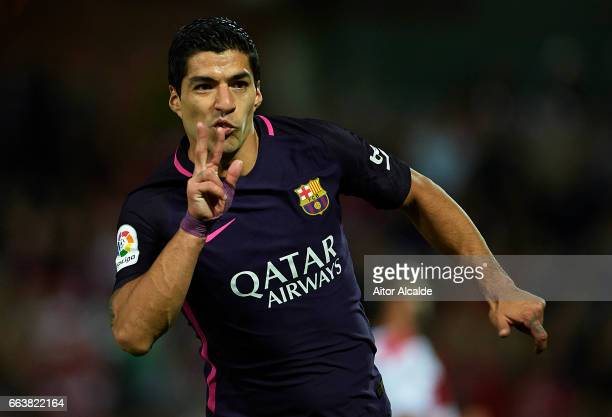 Luis Suarez of FC Barcelona celebrates after scoring the first goal for FC Barcelona during the La Liga match between Granada CF v FC Barcelona at...