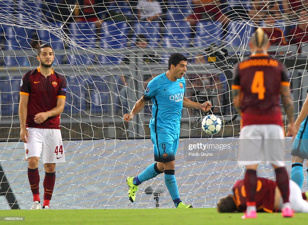Luis Suarez (C) of FC Barcelona celebrates after scoring the opening goal the UEFA Champions League Group E match between AS Roma and FC Barcelona at Stadio Olimpico on September 16, 2015 in Rome, Italy.