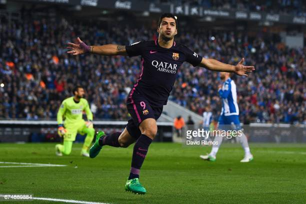 Luis Suarez of FC Barcelona celebrates after scoring the opening goal during the La Liga match between RCD Espanyol and FC Barcelona at the RCDE...