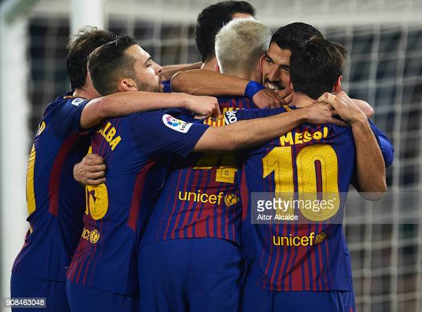 Luis Suarez of FC Barcelona celebrates after scoring the third goal for FC Barcelona with his team mates during the La Liga match between Real Betis...