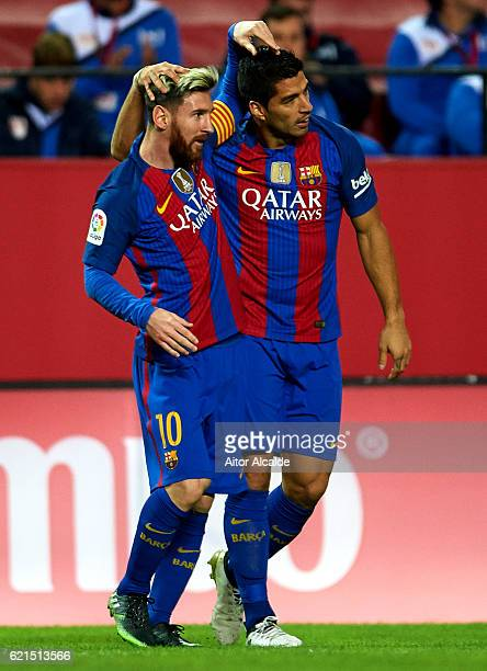 Luis Suarez of FC Barcelona celebrates after scoring with his team mate Lionel Messi of FC Barcelona during the match between Sevilla FC vs FC...