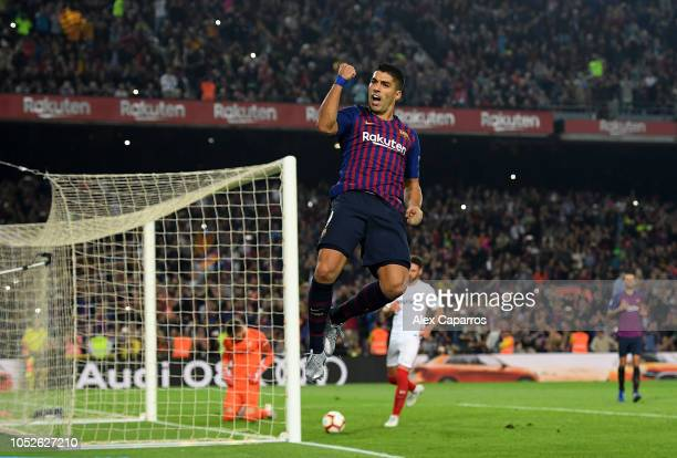 Luis Suarez of FC Barcelona celebrates as he scores his sides third goal during the La Liga match between FC Barcelona and Sevilla FC at Camp Nou on...
