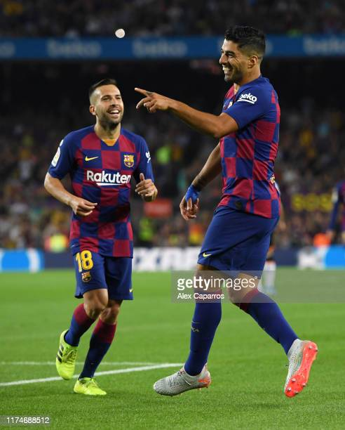 Luis Suarez of FC Barcelona celebrates as he scores his team's fifth goal with Jordi Alba during the Liga match between FC Barcelona and Valencia CF...