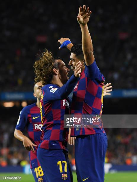 Luis Suarez of FC Barcelona celebrates as he scores his team's fifth goal with Antoine Griezmann during the Liga match between FC Barcelona and...
