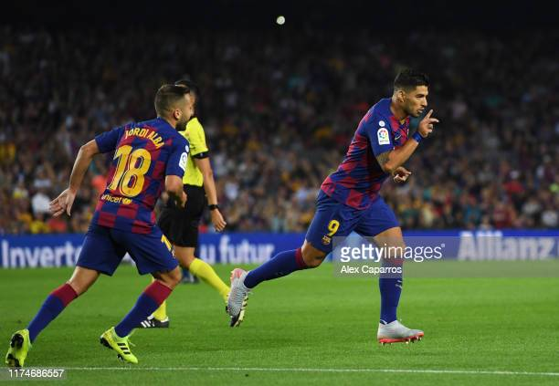 Luis Suarez of FC Barcelona celebrates as he scores his team's fourth goal during the Liga match between FC Barcelona and Valencia CF at Camp Nou on...