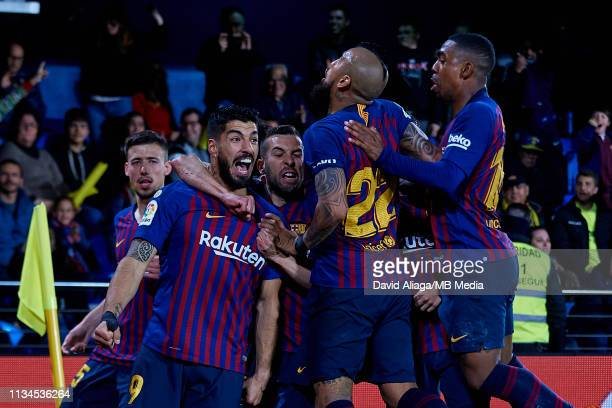 Luis Suarez of FC Barcelona celebrates his sides fourth goal with his teammates during the La Liga match between Villarreal CF and FC Barcelona at...