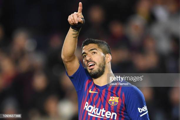 Luis Suarez of FC Barcelona celebrates his team's first goal during the La Liga match between FC Barcelona and SD Eibar at Camp Nou on January 13...