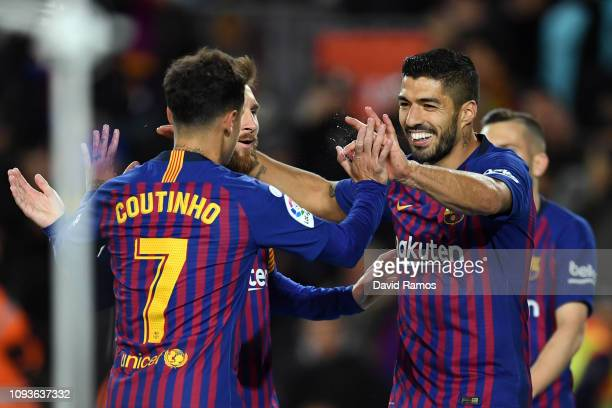 Luis Suarez of FC Barcelona celebrates his team's first goal with team mates Lionel Messi and Philippe Coutinho during the La Liga match between FC...