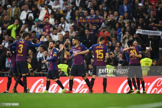Luis Suarez of FC Barcelona celebrates his team's first goal with team mates during the Copa del Rey Semi Final second leg match between Real Madrid...