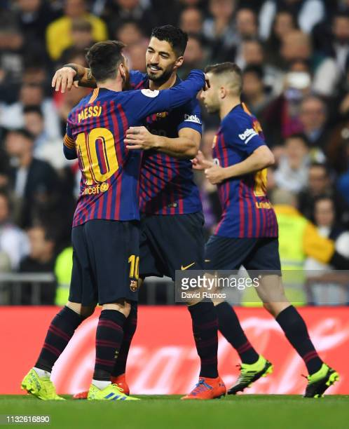 Luis Suarez of FC Barcelona celebrates his team's first goal with team mate Lionel Messi during the Copa del Rey Semi Final second leg match between...