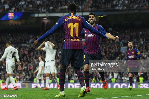 Luis Suarez of FC Barcelona celebrates his team's second goal with team mate Ousmane Dembele during the Copa del Rey Semi Final second leg match...