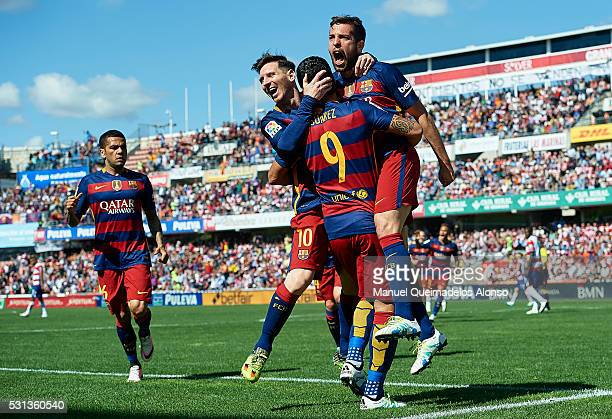 Luis Suarez of FC Barcelona celebrates scoring his team's first goal with his teamates Lionel Messi and Jordi Alba during the La Liga match between...