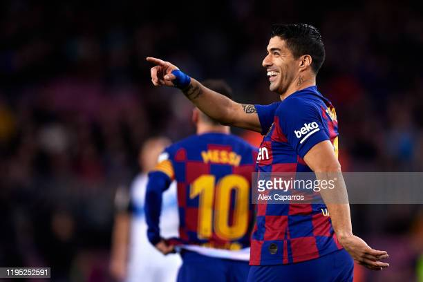 Luis Suarez of FC Barcelona celebrates scoring his team's fourth goal with a penalty kick during the La Liga match between FC Barcelona and Deportivo...