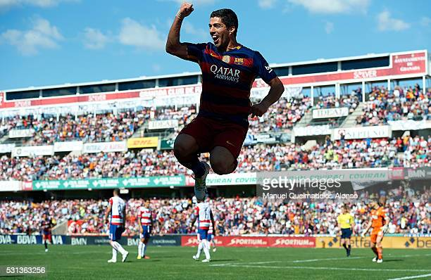 Luis Suarez of FC Barcelona celebrates scoring his team's second goal during the La Liga match between Granada CF and FC Barcelona at Estadio Nuevo...