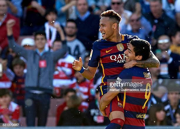 Luis Suarez of FC Barcelona celebrates scoring his team's third goal with his teammate Neymar JR during the La Liga match between Granada CF and FC...